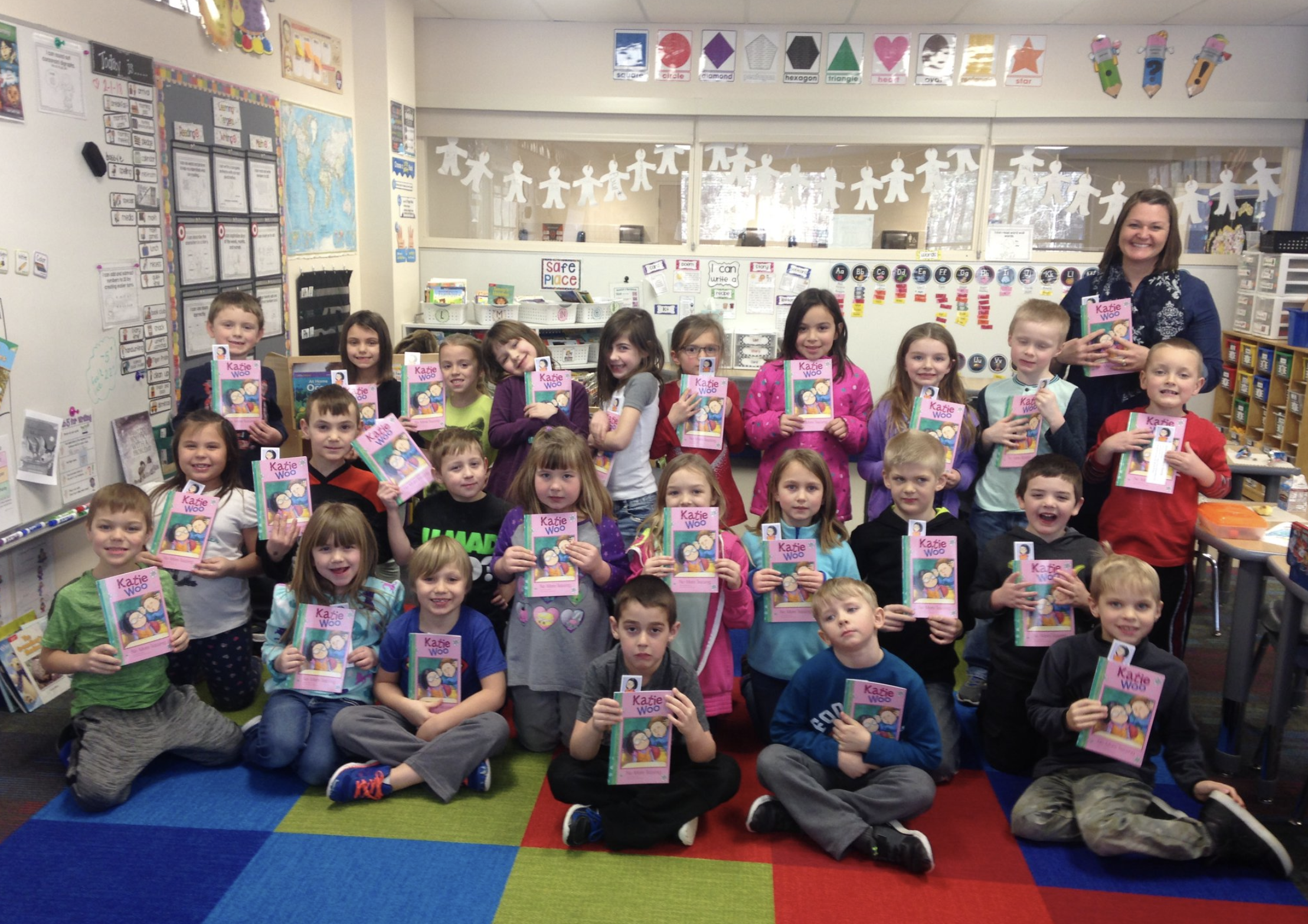 Primary School students with their copies of Katie Woo