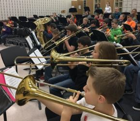 middle school band playing trombones