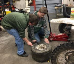 Students replacing a tire