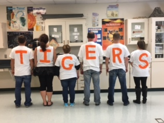 group of students wearing tiger shirts