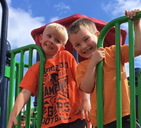 2 boys enjoying after school care on the playground