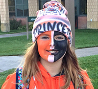 female middle school student showing her princeton pride with face painting
