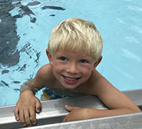 young toddler boy enjoying the aquatics program at Princeton Community Education